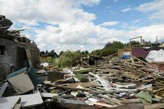 Pieces of wood and bricks surround a destroyed house following a tornado in the village of Osia July 15, 2012.  A freak wave of tornadoes ripped through northern Poland on Sunday.