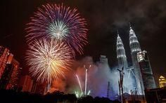Fireworks explode near Malaysia's landmark Petronas Towers during the New Year celebrations in Kuala Lumpur
