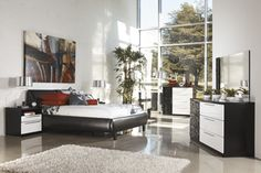"""The two-toned high gloss black and white finish of the """"Piroska"""" bedroom collection features a stunning wave pattern created with """"Infinity Edge(TM)"""" 3D press technology which creates smooth edges and a unique design. The exciting Metro Modern style of this unique furniture is sure to enhance the décor of any bedroom."""