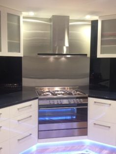 Black and white kitchen with LED lighting under cabinets for that floating effect Kitchens, Kitchen Appliances, Under Cabinet, Wall Oven, Joinery, Cabinets, Led, Black And White, Lighting