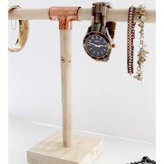 Jewelery holder made out of wood and plumbing supply