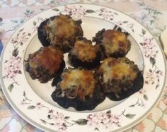 Home-grown portobello mushrooms, stuffed with pesto and other good things. Recipe at http://allrecipes.com/personalrecipe/64090722/pesto-stuffed-grilled-portobellos/detail.aspx.