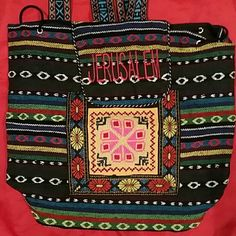 NWOT cross stitch back bag from Palestine NWOT handmade cross stitch back bag. Cross stitch all around and on bottom. Fully lined with soft polyester.  Very beautiful and soft. Draw string and snap closure. Includes a zipper closure compartment in front above the yellow square. Purchased and made in Palestine. Happy Poshing. Bags Backpacks