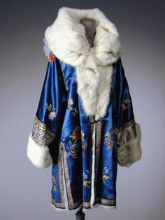 Cerulean Blue Fur Lined Embroidered Evening Coat Chinese, Above the knee length, fashioned with wide fur shawl collar and cuffs, embroidered in pastel tones with flowers, white cuffs with fine peacock and butterfly motifs. 30s Fashion, Fashion History, Art Deco Fashion, Retro Fashion, Vintage Fashion, Feminine Fashion, Fashion Styles, Fashion Clothes, Fashion Ideas