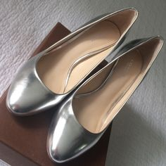 Silver metallic rounded toe pump by Coach The Nala mirror metallic silver pump by Coach. Size 7. Worn only once. I was so eager to buy them that I got a half a size too small. Runs true to size 7.  Heel measures 3 1/2 inches. In excellent to near perfect condition. Original box is available. Coach Shoes Heels