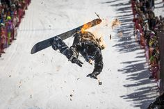 A snowboarder performs during the Red Bull Jump and Freeze competition at ski resort Shimbulak outside Almaty on Sunday. Participants wearing festive costumes perform tricks before getting into a pond with icy water