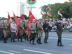 Belarusian Soldiers dressed up as WWII-era Soviet Partisans marching down Victors' Avenue in Minsk at the 2014 Belarusian Independence Day Parade.