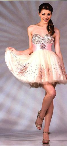 Prom Dresses<BR>Quinceanera  Dresses<BR>Winter Ball Dresses under $120<BR>jc022<BR>Steal Short dress with bead work covering the bust, basque waist .