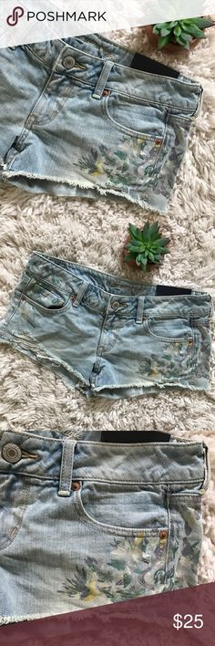 AEO • Painted Denim Short Shorts AEO • Brand new with tags. Painted pattern in pastels on front. Light denim wash. Distressed look. Shortie style. Great condition.   🌸 No trades. 15% off when you purchase at least 2 items from my closet. 🌸 American Eagle Outfitters Shorts Jean Shorts
