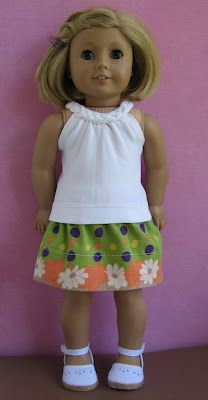 cute way the top is made, blogger says:The green skirt with a cream colored top. I made the cream top from an old knit top of mine: I cut and braided strips of the knit fabric for the neck trim. Site has a lot of tutorials.
