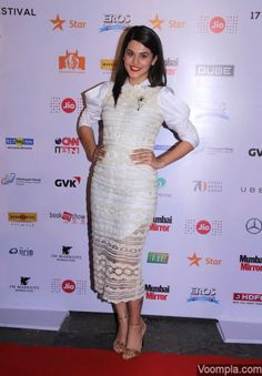 So pretty! Taapsee Pannu looking beautiful in a white Archana Rao Label lace dress. Styled by Devki B, the actress wows the cameras with her smile and red lips. via Voompla.com