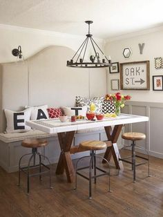 Informal eat-in-kitchen table but the bench makes it more formal...love it! HATE the stools though