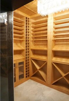 Our client in a spectacular house in West Vancouver wanted a traditional feel with cutting edge performance. The room is made with elegant oak finished by lacquer featuring horizontal wine shelves with classic criss·cross The wine shelves include storage and display areas with mesh screen doors. This wine cellar complements the natural beauty of the home and location. Mesh Screen Door, Screen Doors, Wine Shelves, Wine Cellars, Criss Cross, Vancouver, Natural Beauty, Display, Traditional