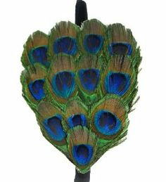 Peacock Eye Feather Head Band by CoverYourHair. $24.74. Hand Made. Durable. Adjustable. Looks Great On. Comfortable on The Head. This is a 1/5 inch metal headband with a genuine peackock feather. Very cute and dressy item.