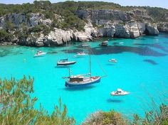 Sail the Islands of Greece.  The water is so clear the boats look like they are floating!