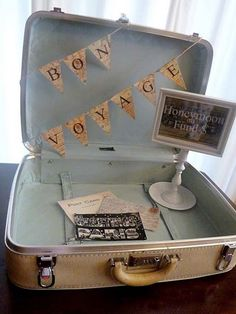 Cute (vintage) Idea! Bon Voyage Suitcase ready to receive gift cards to aid in a wonderful Honeymoon trip!