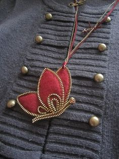 red butterfly by zipper and felt
