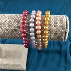 Set of 4 Honora pearl bracelets Set of 4 ringed freshwater pearl stretch bracelets. Perfect colors for summer! EUC. Honora Jewelry Bracelets