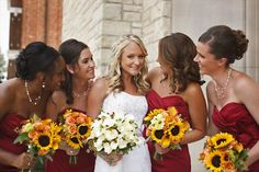 """We wanted 'fall' colors for our end of summer/ beginning of fall wedding. The bridesmaids wore wine color dresses and carried bouquets of burnt orange calla lilies, orange roses, and sunflowers!"""