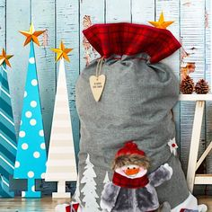 Our gorgeous frosty character is wrapped up perfectly to take centre stage on our Luxury Winter Grey Snowman Sack with Name Tag Now he is just