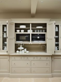 Our custom by-fold door system. Great for hiding worktop clutter ...