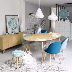 This space is balance with different textures from the kind of carpet design in the floor, contrasted with some texture in the fabric of the chairs, the wooden furniture and the picture frame , the clock and other wall accents soften and warm the white background space