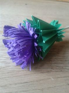 Origami paper Scottish Thistle... they said it could be done... ta-da! www.flairforfleur.co.uk
