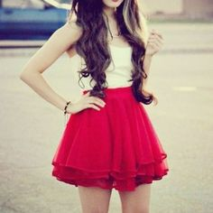 A very cute white blouse with the red skirt to give a feminine touch and a pop of color.