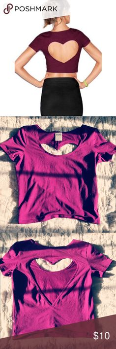 VS purple crop top with back ❤️ Size XS Plum purple Victoria's Secret PINK crop top tee with heart detail in the back! Stretchy smooth fabric with embroidered dog on the front right bottom hem. Double stitching at the seems except bottom hem.  WEAR IT: to the gym with your leggings, Saturday shopping with skinny joggers, dress it up with a skirt and heels PINK Tops Crop Tops