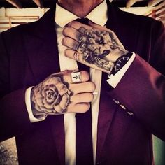 Fancy suit and hand tattoos