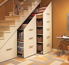 10 unique ways to utilize understair storage areas  - like these wooden drawers