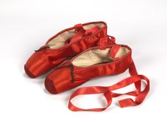 Freed of London (founded in 1929), red ballet shoes made for Victoria Page (Moira Shearer) in The Red Shoes (1948), silk satin, braid and leather, England, 1948, Northampton Museums and Art Gallery #vamShoes http://www.vam.ac.uk/shoes