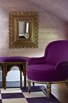 A chair upholstered in beautiful amethyst is fit for royalty. - Traditional Home ® / Photo: John Bessler / Design: Jamie Drake