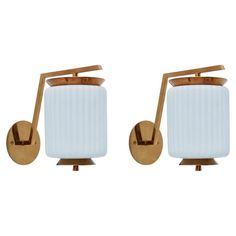 Italian Riveted Cylinder Sconces | From a unique collection of antique and modern wall lights and sconces at https://www.1stdibs.com/furniture/lighting/sconces-wall-lights/