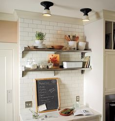 Open Shelving in a black and white kitchen design featuring Hannah semi-flush light fixtures from Rejuvenation