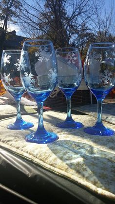 Check out this item in my Etsy shop https://www.etsy.com/listing/257785822/blue-glass-wine-glasses-with-etched