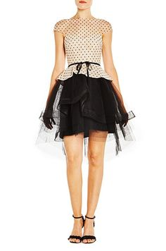 Creme noir flocked dotted tulle dress with tiered skirt. Illusion neckline with fitted bodice and noir grosgrain belt at waist. Silk lined. Tulle Dress, Dot Dress, Illusion Neckline, Fitted Bodice, Bridal Collection, Grosgrain, Cap Sleeves, Skater Skirt, Shop Now