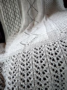 I wanted to showcase my recently acquired lace-knitting skills by making something beautiful and feminine for my mother. Looking through a few knitting books, I got inspired to put four lace patterns together. The edges of the Lace Blanket Shawl are worked in one lace pattern, and the main body is three lace panels worked at the same time to give a highly textural blanket that is beautiful to look at and warm to snuggle under.