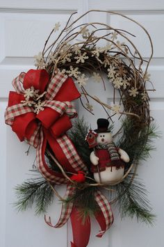 Country Snowman Grapevine Wreath    How cute and homey! This adorable little stuffed snowman and a little cardinal sit on some honeysuckle