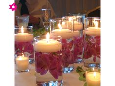 floating candle centerpieces, how to make them, how to choose bowls and holders. Wedding centerpieces with floating candles you can make yourself. Diy Centerpieces Cheap, Floating Candle Centerpieces, Wedding Reception Centerpieces, Wedding Decorations, Centerpiece Ideas, Reception Ideas, Orchid Centerpieces, Reception Table, Wedding Receptions