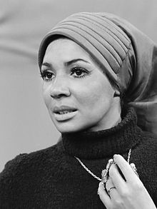 "Dame Shirley Veronica Bassey, DBE (born 8 January 1937[1]) is a Welsh singer. She found fame in the mid-1950s and has been called ""one of the most popular female vocalists in Britain during the last half of the 20th century"".[2][3] In the US, in particular, she is best known for recording the theme songs to the James Bond films Goldfinger (1964), Diamonds Are Forever (1971), and Moonraker (1979)."