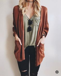 comfy orange cardigan with black ripped jeans and sunnies.
