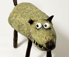 """Adopt Benicio! He is a pet that wont give you any trouble.    Sculpture is approx. 13 high and measures 18"""" by 6"""" in width and depth, about the size of a real dog.    All pets are very sturdy, made from paper mache (from recycled newspaper) with a wire skeleton inside. Details, like eyes, noses and teeth are made from polymer clay. The sculptures are lovingly hand-painted with acrylic paint and a little gloss for an extra spark on the eyes and nose.  These guys will do better indoors, they…"""