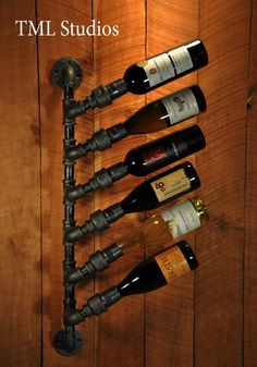 Industrial Plumbing Pipe Wine Rack Bottle Holder by TMLStudios.long pipe above the cabinets with wine bottles ect Plumbing Pipe Furniture, Industrial Furniture, Furniture Vintage, Furniture Ideas, Industrial Pipe, Industrial Style, Vintage Industrial, Bar Deco, Deco Originale