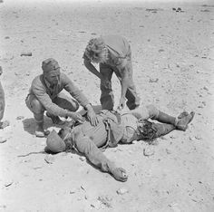 BRITISH ARMY NORTH AFRICA 1942 (E 14241)   Soldiers search the body of an Italian infantryman for identification, 11 July 1942.