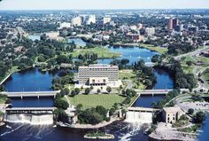Ottawa from the Air ... Looking south over Green Island at the mouth of the Rideau River.   Just above Old City Hall and a little to the right, you can see the remains of the bridge that carried Ottawa's original railway tracks over the Rideau to Sussex Street in Lowertown (This was for Bytown and Prescott, eventually taken over by CP)   The Vanier Parkway was built on the top of the continuation of the tracks down the east side of the Rideau.