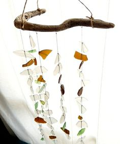 Make a Sun Catcher Sea Glass Chime-great way to use solids in a fun way. Of course because glass is translucent, these would look pretty in front of a window! Now I know what to do with all my brother's river glass!