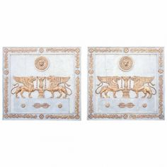 """Pair of Period Empire Boiserie Painted and Parcel Gilt Panels with winged griffons and ringed lions with laurel swag decoration, all on oak planks, France, 19th c., Height: 41"""" Width: 44"""" Depth: 2"""""""