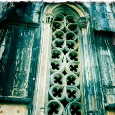 gorgeoso: intricate arched window, weathered teal exterior...♥