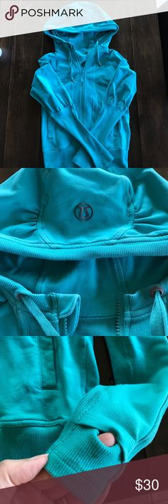 Lululemon aqua zip up hoodie size 6 Love this bought from another posher it's in good used condition minor stains on left wrist area- now here's the thing she sprayed it with ANGEL the perfume. I have washed it twice and it still has a faint smell. I would keep this because it's so dang cute but I am a size 8 so it didn't fit me right 🌈 lululemon athletica Jackets & Coats